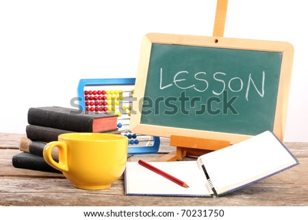 green blackboard and book close up - stock photo