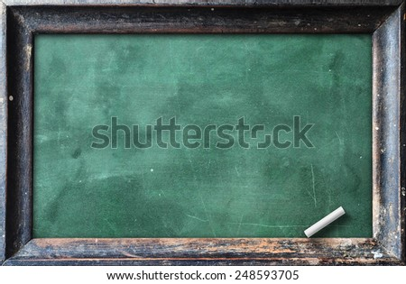 Green blackboard in wooden frame with chalk. - stock photo