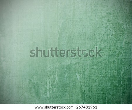 Green blackboard texture background with light source fro upper left hand corner and black vignette  - stock photo