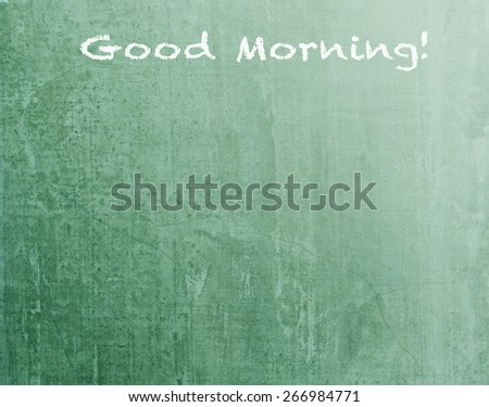"""Green blackboard texture background with text """" Good Morning"""" (light source from upper right hand corner  - stock photo"""