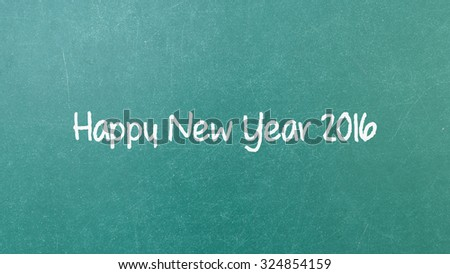 Green blackboard with hand written words note Happy New Year 2016 - stock photo