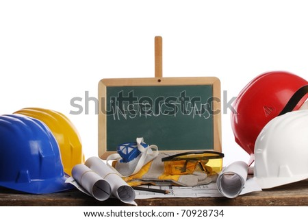 green blackboard with helmets - stock photo