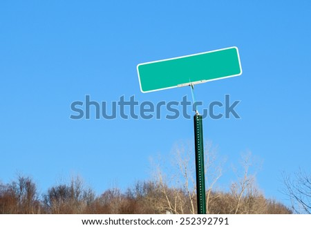 Green Blank Street Sign Against Blue Sky for your Copy - stock photo