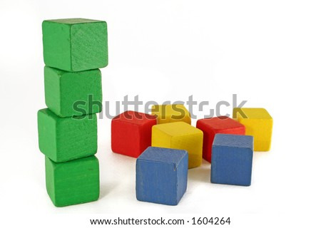 green block tower standing and other colors scattered. Environmental / organic concept - stock photo