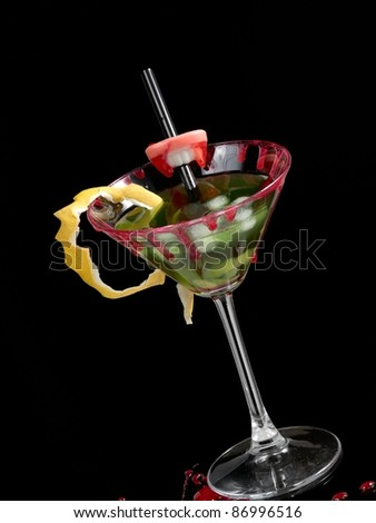 Green bloody cocktail in martini glass - stock photo