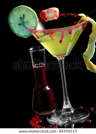 Green bloody cocktail with blue lemon - stock photo