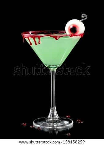 Green bloody Halloween cocktail in martini glass - stock photo