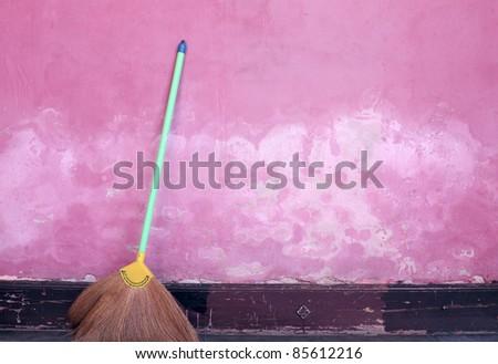 green bloom at grunge wall - stock photo