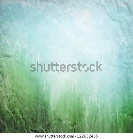 green blue abstract landscape on crumbled paper ; vintage background