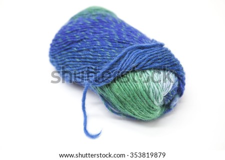 Green blue ball of wool yarn for knitting close up on a white background - stock photo