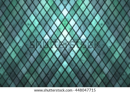 Green blue colored blurry abstract stained glass window detail background