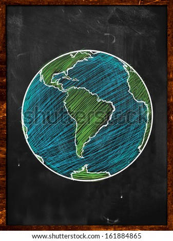 Green blue Earth on Blackboard - Globe background - stock photo