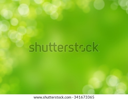 Green blur bokeh abstract nature background and wallpaper - stock photo