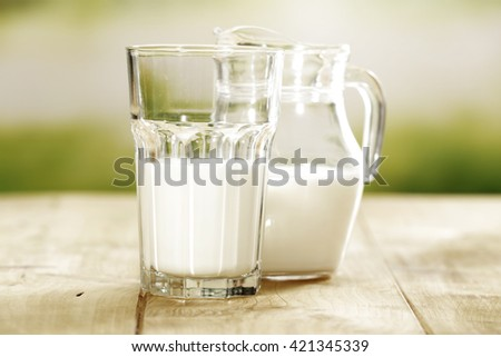 green blurred background and desk and milk space  - stock photo