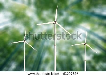 Green blurred background wind turbines. - stock photo