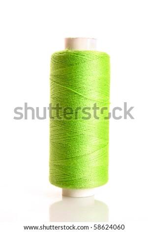 green bobbin thread isolated on white - stock photo