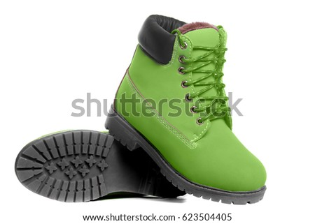 Green boots. Angle view. Isolated on white background