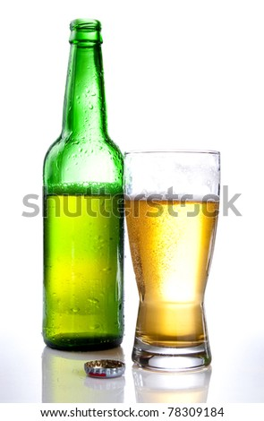 Green bottle and Half drank beer mug isolated on white background