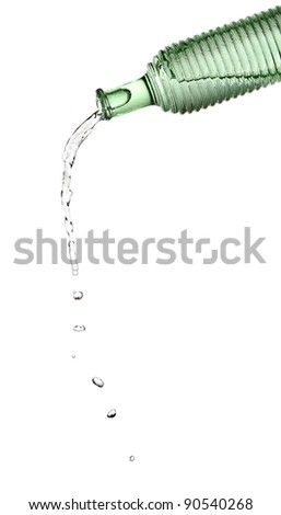 green bottle and water pouring out on white background