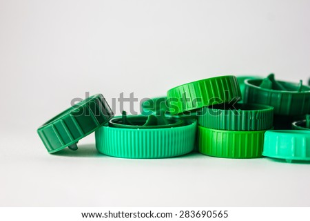 Green bottle caps with white background
