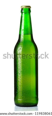Green bottle of beer with drops on white background - stock photo