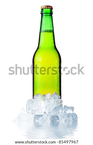 Green bottle of beer with ice isolated on white background