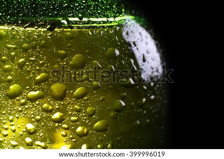 Green bottle of fresh beer, closeup - stock photo