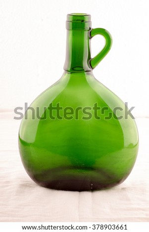 Green bottle on white background