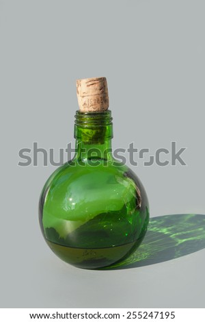 Green bottle with poison in it