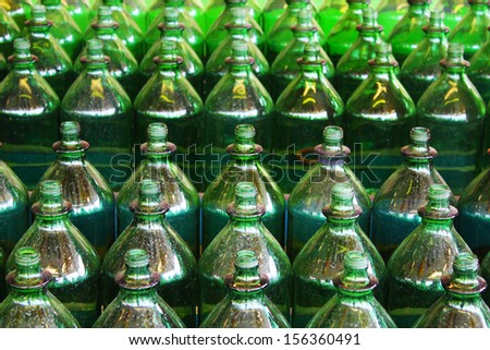 Green bottles in a row - stock photo