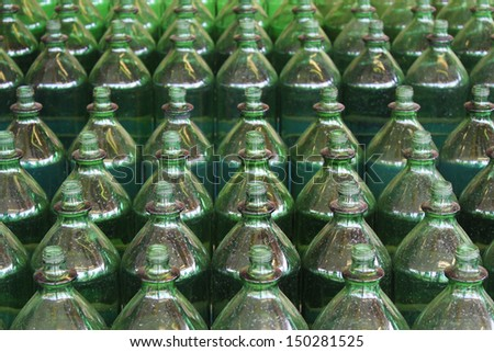 Green bottles in neat rows - stock photo
