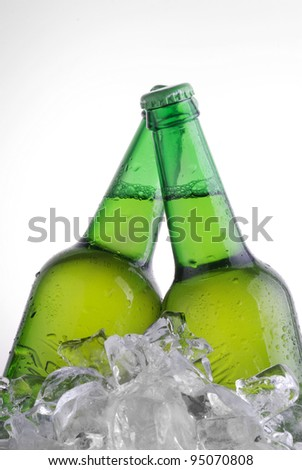 green bottles of beer chilling on ice