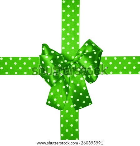 green  bow and ribbon with white polka dots made from silk isolated - stock photo