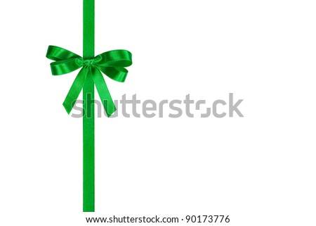 Green bow and vertical ribbon isolated on white - stock photo