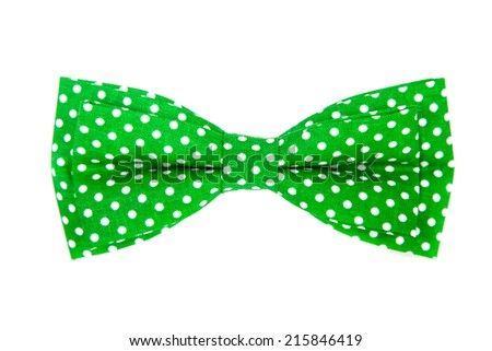 green bow tie with white polka dots on an isolated white background - stock photo