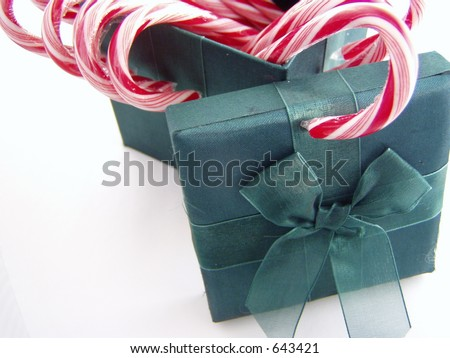 green box of candy canes on white - stock photo