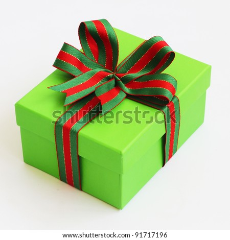 Green box with a  ribbon bow.