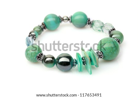 green bracelet on white - stock photo