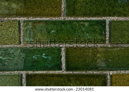 green brick wall - stock photo