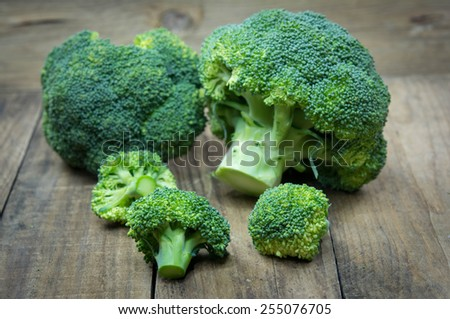 green broccoli on wooden - stock photo