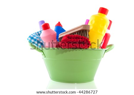 Green bucket full with cleaning products isolated over white