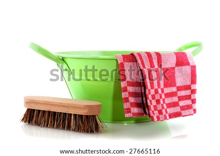 Green bucket with cleaning brush and cloth - stock photo