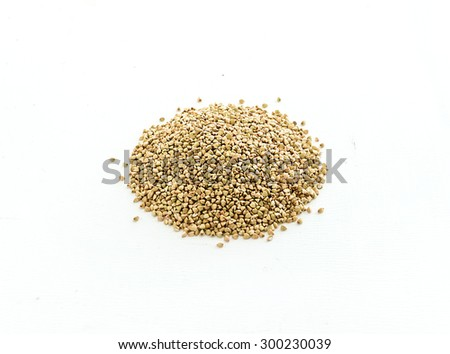 Green buckwheat groats on white background. Top view - stock photo