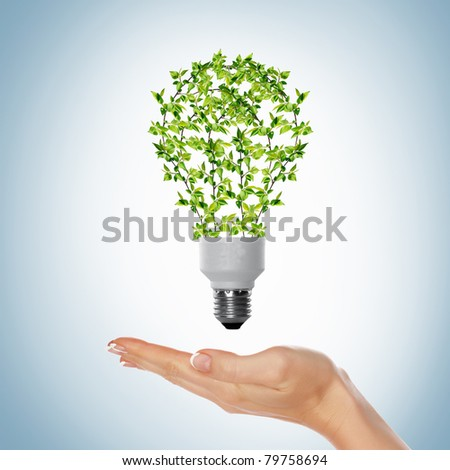 green bulb as symbol of sustainable energy and nature protection - stock photo