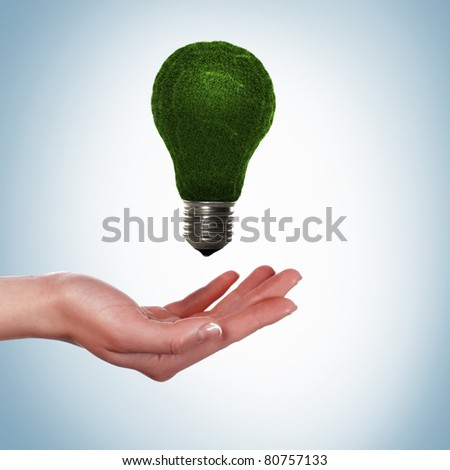green bulb as symbol of sustainable energy and nature protection