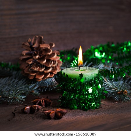 green burning candle with decoration  - stock photo