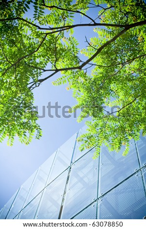 Green business and office building with reflections