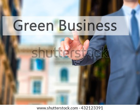 Green Business  - Businessman hand pressing button on touch screen interface. Business, technology, internet concept. Stock Photo - stock photo