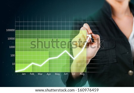 Green business graph showing growth close up - stock photo