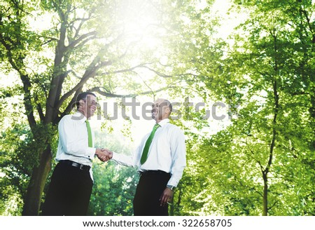 Green Business Handshake Deal Support Concept - stock photo